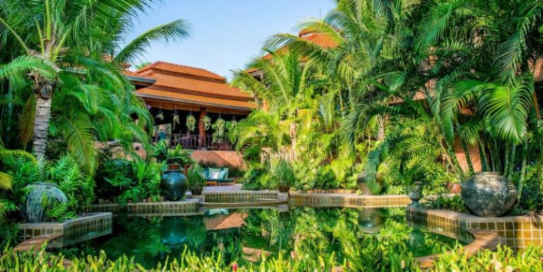 Large tropical garden with swimming pool