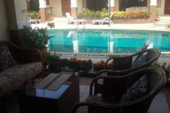 12 Furnished veranda with pool view