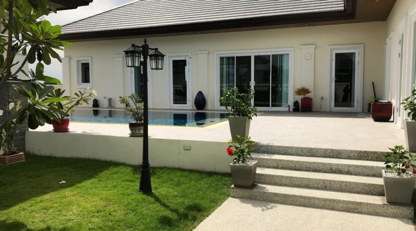 02 Villa facade with pool and patio