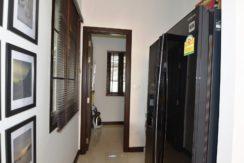 26 Storage-laundry room behind kitchen