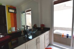 35 Ensuite master bathroom with outside bathtub