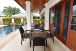 04 Shaded furnished patio along facade