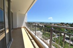 12 Large balcony traversing the condo