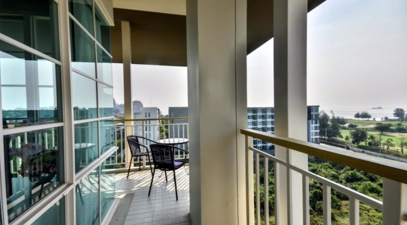 12 Corner balcony with sea and golf view